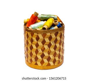 braided manually birchbark cylindrical box with spools of colored threads isolated on white background