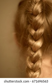 Braided pigtail in a little girl close