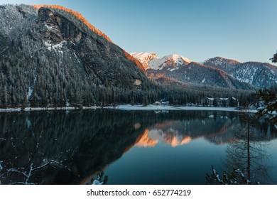 Braies Lake, Dolomites, Trentino Alto Adige, Italy in morning sunrise, mountain reflection in water.