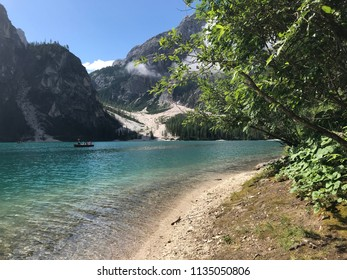 Braies lake in Italy. Trees with mountains and sky