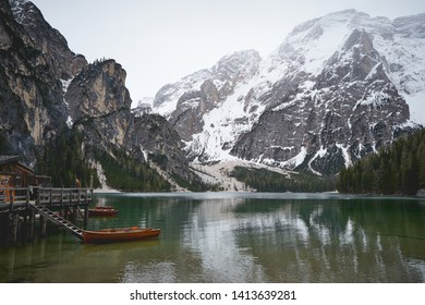 Braies Lake (lago di Braies in Italian) in Dolomites mountains forest trail in background, Sudtirol, Italy. The lake is surrounded by forest famous for scenic hiking trails. Landscape format.