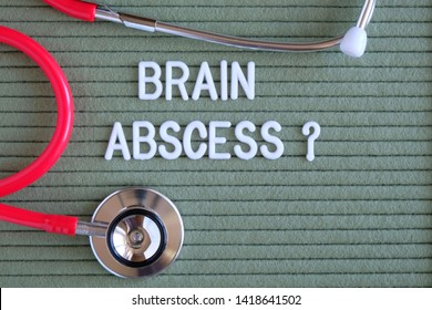 Brain abscess- text with a question mark on  green background with  stethoscope, medical concept diagnostics, treatment, healthcare.