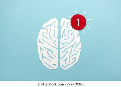 Brain alert - white paper cut brain silhouette with red notification alert, useful image to illustrate ideas, alertness, thinking