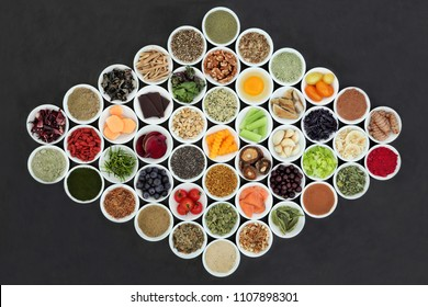 Brain boosting healthy super food concept in porcelain bowls on slate background. Foods high in antioxidants, omega 3, anthocyanins, minerals and vitamins.