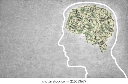 Brain currency / outline of a man's head with the brain in the shape of money