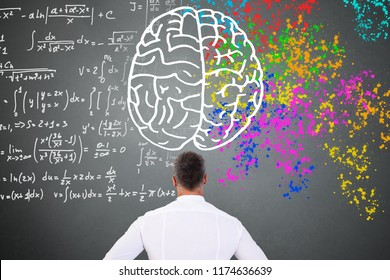 Brain Diagram Over Man Looking At Blackboard With Left Right Brain Diagram