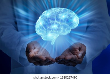 Brain disease concept. Cropped of black doctor in white holding lightened human brain, collage