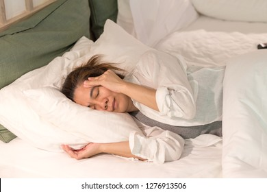 Brain diseases problem cause chronic severe headache migraine. Asia woman adult look tired lay down on bed, having mental problem trouble, healthcare medical concept