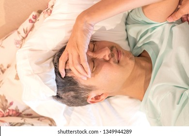 Brain diseases problem cause chronic severe headache migraine. Male adult look tired and stressed out depressed, having mental problem trouble, medical concept