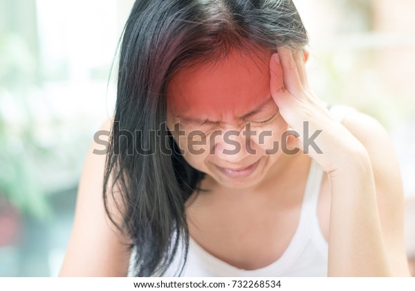 Brain diseases problem cause  chronic severe headache migraine in woman. Female adult look tired and stressed out depressed, having mental problem trouble, medical concept