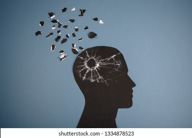 Brain disorder symbol presented by human head made form paper . Creative idea for Alzheimer's disease, dementia, memory loss and mental