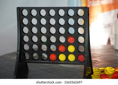 Brain game. Frame and coins of connect 4 game that requires intelligence to win.