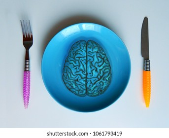 The brain, like food, lies on a plate ready for cutting and eating