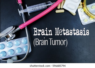 Brain Metastasis (Brain Tumor) word, medical term word with medical concepts in blackboard and medical equipment.