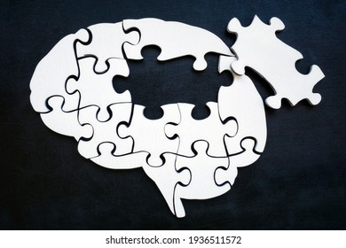 Brain from puzzle pieces with one missing. Memory problems and Alzheimer disease.