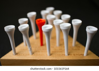 Brain teaser game with pegs on a wooden triangle