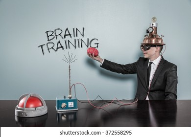 Brain training concept with businessman holding brain