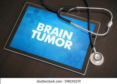Brain tumor (cancer type) diagnosis medical concept on tablet screen with stethoscope.