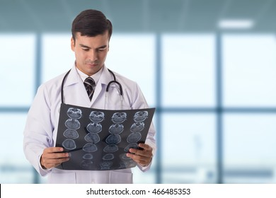 Brain xray film scan.Doctor analysis head of patient in hospital.