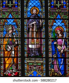 BRAINE-LE-CHATEAU, BELGIUM - JULY 31, 2009: Stained Glass window in the Church of Braine-le-Chateau, Wallonia, Belgium, depicting Saint Francis Xaverius and two other catholic saints.