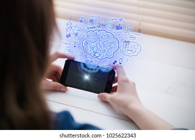 Brainstorm against close up view of businesswoman using her phone