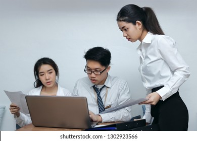 Brainstorm business concept. Confident young Asian employee working together on workplace in office.