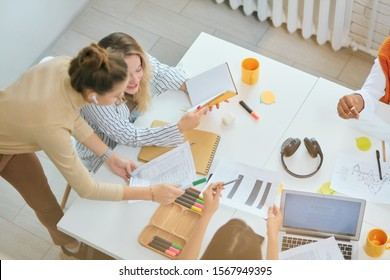 Brainstorm of successful business team, coworking of young diverse business women using laptop, creative modern business aims and ideas, solutions of problem. Togetherness