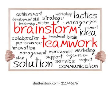 brainstorm teamwork and other related words handwritten on whiteboard with hands