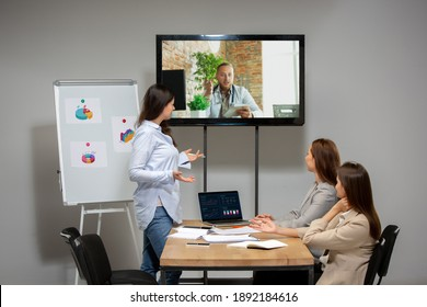 Brainstorm. Young women talking, working in videoconference with colleagues, co-workers at office or living room. Online business, education during insulation, quarantine. Work, finance, tech concept.
