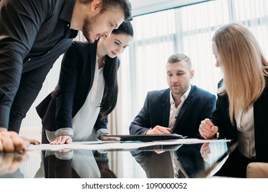brainstorming. briefing meeting. business discussion. team of managers or executives thinking over a strategy or company development and studying information