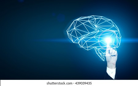 Brainstorming concept with businessman hand pointing at abstract illuminated polygonal brain on dark blue background