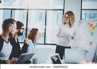 Brainstorming process at office.Young coworkers making together new business project at modern meeting room.Horizontal.Blurred background