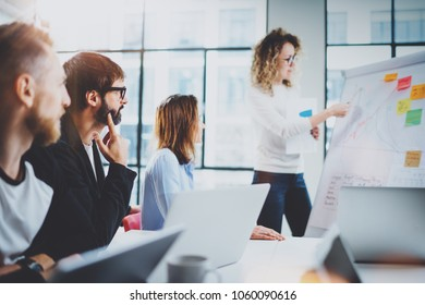 Brainstorming process at office.Young coworkers working together new ideas at modern meeting room.Horizontal.Blurred background