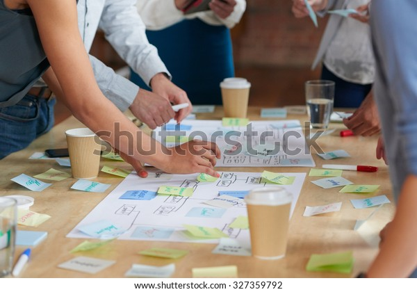 Brainstorming session with post it notes on desk