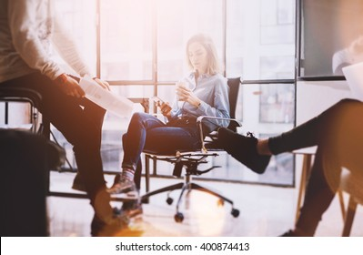 Brainstorming time.Photo young business crew working with new startup project.Idea presentation, analyze marketing plans. panoramic windows background.Creative process.Blurred background, film effect.