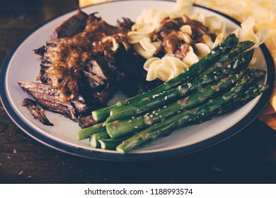 braised beef short rib with pasta and vegetables