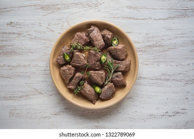 Braised beef slices on a plate. Beef stew.