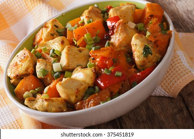 Braised chicken curry with vegetables in a bowl close-up. horizontal