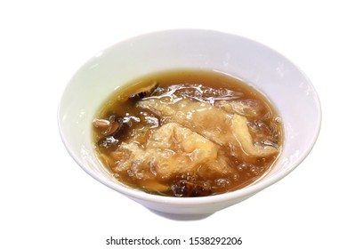 braised fish maw and mushroom in red gravy on bowl