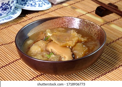 Braised Fish Maw in Red Gravy, famous Hakka cuisine in China, Hong Kong, Taiwan, Thailand. In Chinese food culture, fish maw is a type of food that promotes longevity or wondrous health benefits.