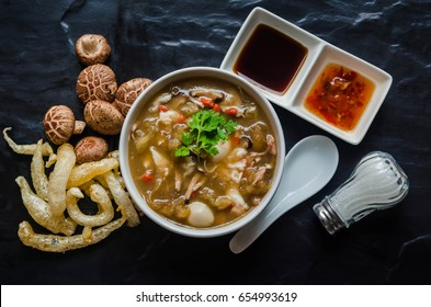 Braised Fish Maw in Red Gravy,Fish Maw soup on black stone background.