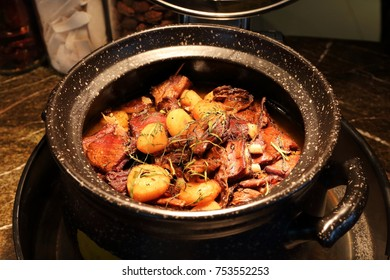 Braised lamb, with water chestnut and herbs, in a pot, ready to be served