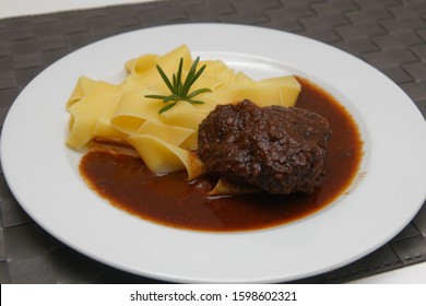 Braised ox cheeks with noodles