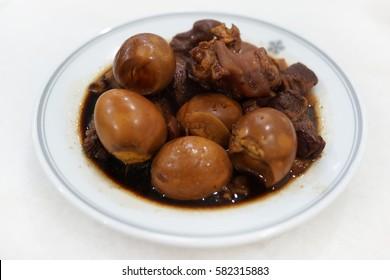 braised pig's trotters, eggs with brown soya sauce, rice wine vinegar. chinese food