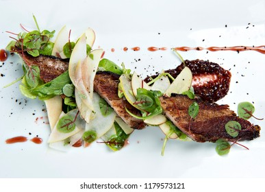 Braised Pork Belly with Apples and Cranberry Sauce on White Plate