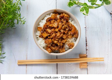 braised pork on rice is Minced pork served with pickles on top of steamed rice