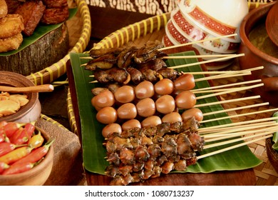 Braised Satays of Chicken Offal, Quail Eggs, and Cockles for Nasi Soto Kudus. Traditional skewered side dishes that accompany Nasi Soto Kudus, the Javanese chicken soup from Kudus.