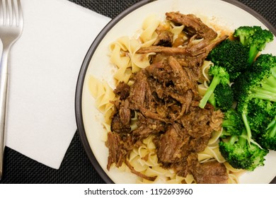 braised tender short ribs pulled apart over vegetables with gravy