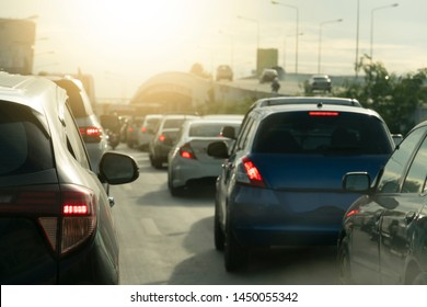 Brake cars on the road during traffic jams in urban areas, have different levels of bridges to head to other directions, smoke pollution from exhaust pipes