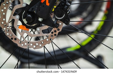 Brake disc of a front bicycle wheel. Mountain bike details, close up photo